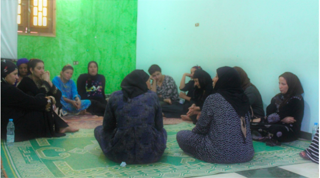 Women in a storytelling circle in Upper Egypt